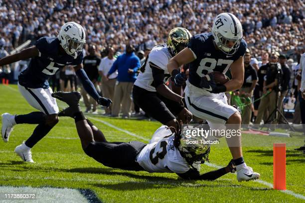 Pat Freiermuth of the Penn State Nittany Lions scores a touchdown against the Purdue Boilermakers during the first half at Beaver Stadium on October...