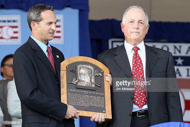 Pat Gillick accepts his plaque from Hall of Fame president Jeff Idelson at Clark Sports Center during the Baseball Hall of Fame induction ceremony on...