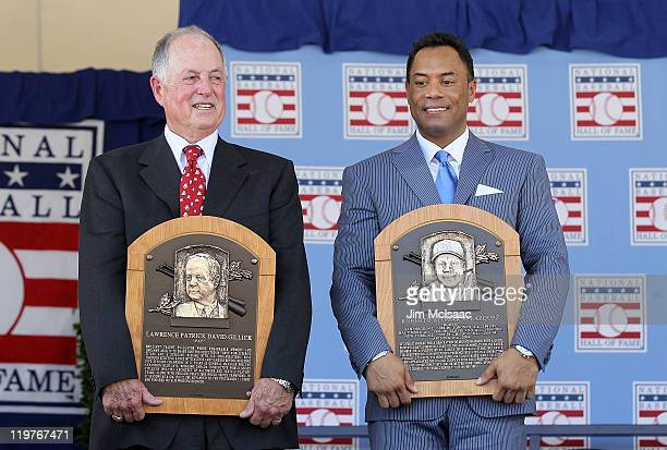 Pat Gillick and Roberto Alomar pose with their plaques after their induction at Clark Sports Center during the Baseball Hall of Fame induction...