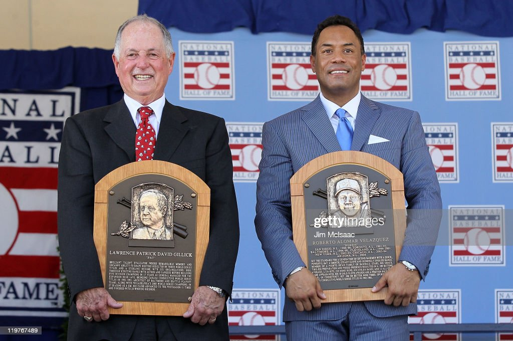 Pat Gillick (L) and Roberto Alomar pose with their plaques after their induction at Clark Sports Center during the Baseball Hall of Fame induction ceremony on July 24, 2011 in Cooperstown, New York. In 17 major league seasons, Alomar tallied 2,724 hits, 210 home runs, 1,134 RBI, a .984 fielding percentage and a .300 batting average.Gillick spent 27 years as the general manger with four major league clubs (Toronto 1978-94, Baltimore 1996-98, Seattle 2000-03 and Philadelphia 2006-08). His teams advanced to the postseason 11 times and won the World Series in 1992, 1993 and 2008.