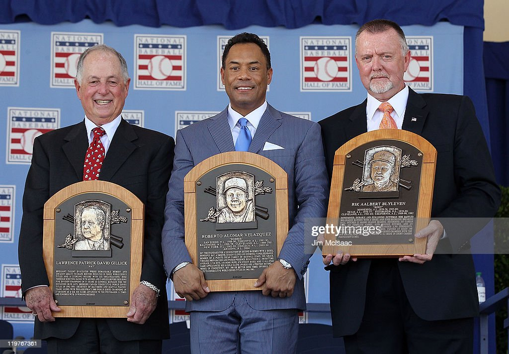 Pat Gillick, Roberto Alomar and Bert Blyleven pose with their plaques after their induction at Clark Sports Center during the Baseball Hall of Fame induction ceremony on July 24, 2011 in Cooperstown, New York. In 17 major league seasons, Alomar tallied 2,724 hits, 210 home runs, 1,134 RBI, a .984 fielding percentage and a .300 batting average. Blyleven finished his 22 season career with 3,701 strikeouts (fifth on the all-time list) and 287 wins including 60 shutouts and 242 complete games.Gillick spent 27 years as the general manger with four major league clubs (Toronto 1978-94, Baltimore 1996-98, Seattle 2000-03 and Philadelphia 2006-08). His teams advanced to the postseason 11 times and won the World Series in 1992, 1993 and 2008.