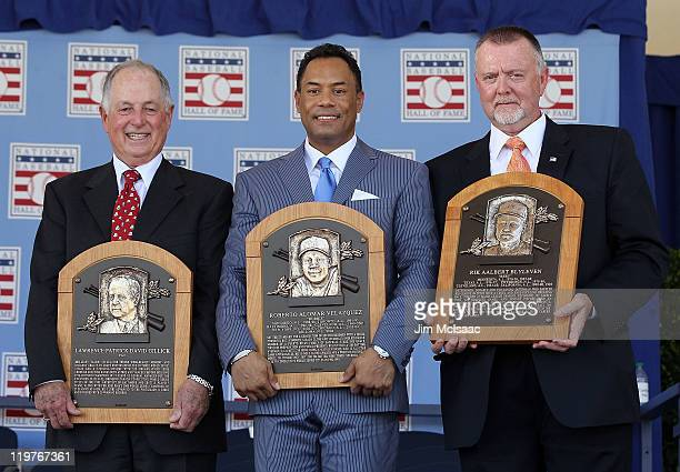 Pat Gillick, Roberto Alomar and Bert Blyleven pose with their plaques after their induction at Clark Sports Center during the Baseball Hall of Fame...