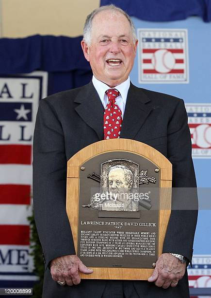 Pat Gillick stands with his plaque at Clark Sports Center during the Baseball Hall of Fame induction ceremony on July 24 2011 in Cooperstown New...