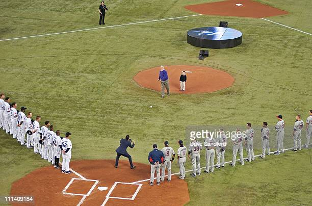 Pat Gillick throws the first pitch to Roberto Alomar prior to the home opener for the Toronto Blue Jays as they face the Minnesota Twins during their...