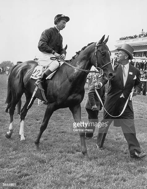Pat Glennon rides Sea Bird II to the winners' enclosure after winning the Epsom Derby 2nd June 1965
