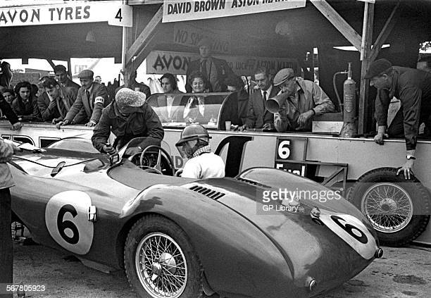 Pat Griffiths and Peter Collins Aston Martin DB3S one of the David Brown works team cars in the pits at Goodwood England 1953