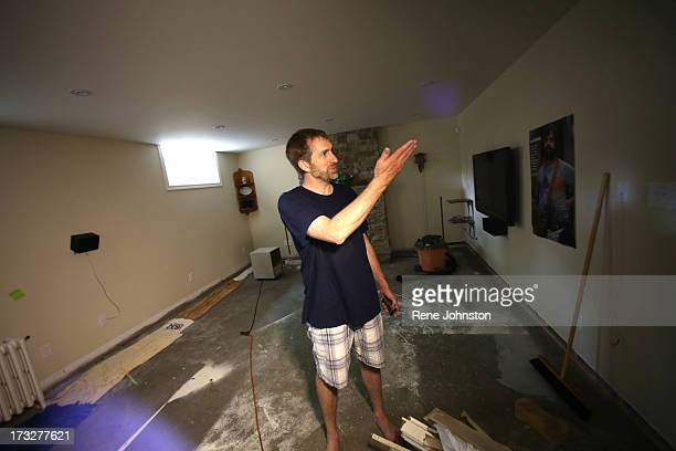 TORONTO ON JULY 10 Pat Hawkins in his basement that was flooded Royal York and Bloor area of the city has been without regular power since the storm...