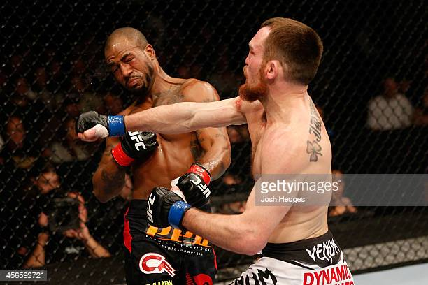 Pat Healy punches Bobby Green in their lightweight bout during the UFC on FOX event at Sleep Train Arena on December 14 2013 in Sacramento California
