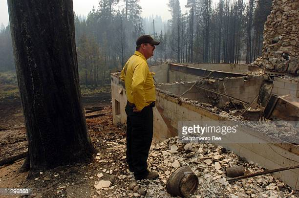 Pat Hennessy, a private contractor for the Department of Forestry, walks through the remains of of his home in South Lake Tahoe, California, Monday,...