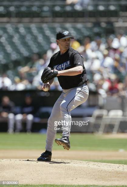 Pat Hentgen of the Toronto Blue Jays pitches during the game against the Oakland A's at Network Associates Coliseum on June 5 2004 in Oakland...