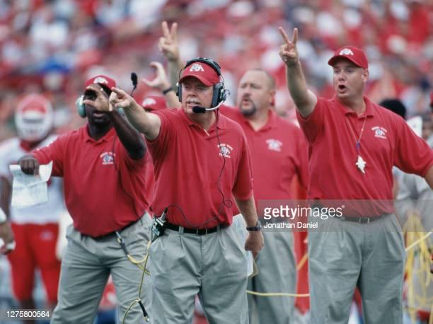 Pat Hill, Head Coach for the Fresno State Bulldogs makes hand signals with his coaching staff to his players during the NCAA Big Ten college football...