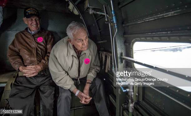 Pat Hofferbert left and Buhl Palmer look out the window of a B24 Liberator while it flies over Orange County on Friday May 12 2017