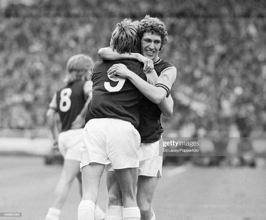 Pat Holland (right) hugs goal scorer Alan Taylor of West Ham United during the FA Cup Final against Fulham at Wembley Stadium in London on 3rd May 1975. West Ham United won 2-0 with Alan Taylor scoring both of their goals.
