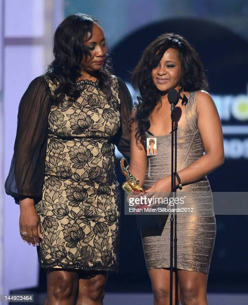 Pat Houston and Bobbi Kristina HoustonBrown accept the Millennium Award on behalf of Whitney Houston onstage at the 2012 Billboard Music Awards held...