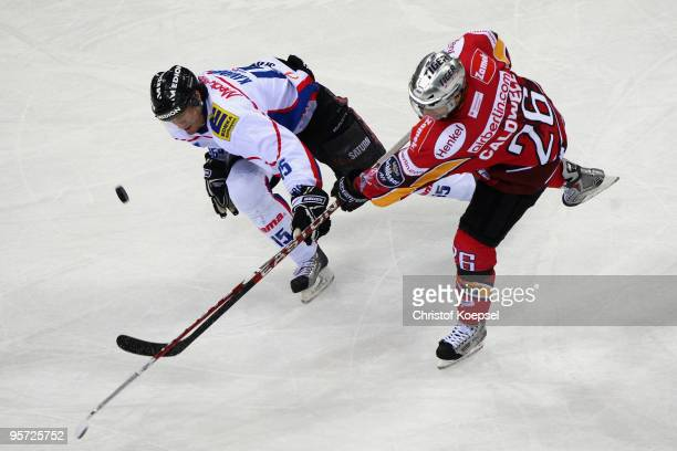 Pat Kavanagh of ERC Ingolstadt tackles Ryan Caldwell of DEG Metro Stars during the DEL match between DEG Metro Stars and ERC Ingolstadt at the ISS...