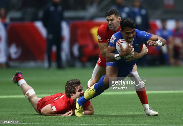 Pat Kay and Justin Douglas of Canada tackle Murphy Paulo of Samoa during the Canada Sevens the Sixth round of the HSBC Sevens World Series at the BC...