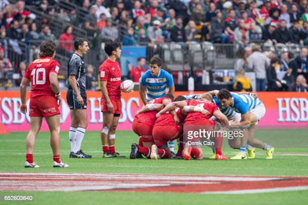 Pat Kay and Nathan Hirayama of Canada stand outside the scrum against Argentina during day 2 of the 2017 Canada Sevens Rugby Tournament on March 12...
