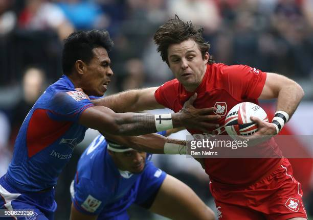 Pat Kay of Canada runs the ball against Murphy Paulo of Samoa during the Canada Sevens the Sixth round of the HSBC Sevens World Series at the BC...
