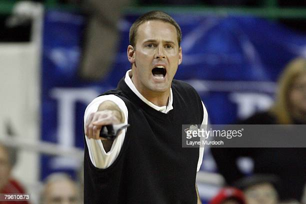 Pat Knight Head Coach of the University of Texas Tech Red Raiders basketball team shouts instructions to his team as they take on the University of...