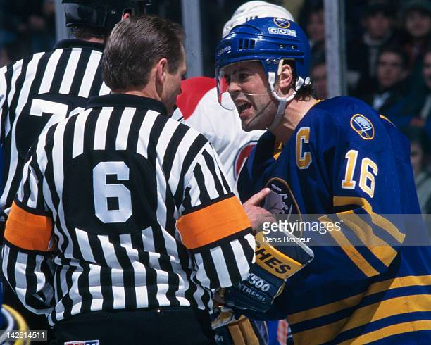 Pat Lafontaine of the Buffalo Sabres argues a call with the referee Circa 1990 at the Montreal Forum in Montreal Quebec Canada