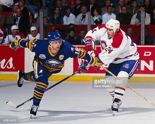 Pat Lafontaine of the Buffalo Sabres gets tripped by Lyle Odelein of the Montreal Canadiens Circa 1990 at the Montreal Forum in Montreal Quebec Canada