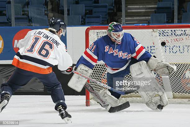 Pat Lafontaine of the New York Islanders Alumni scores on Mark Laforest of the New York Ranger Alumni team during the Hockey for Heroes 3 on 3 Hockey...
