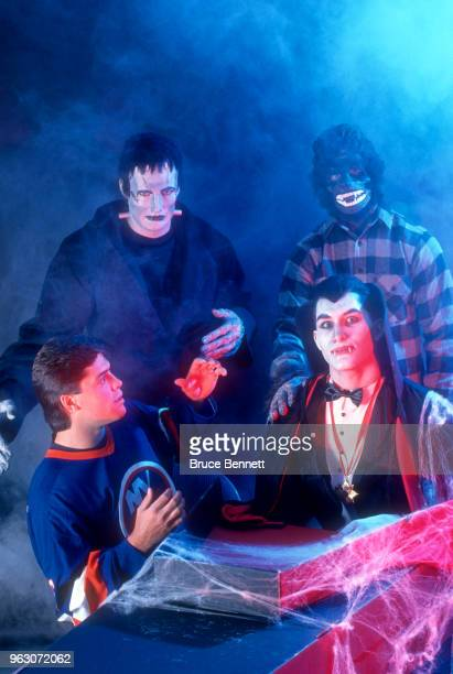 Pat LaFontaine of the New York Islanders looks scared with Frankenstein the Werewolf and Dracula during a Halloween party circa October 1989 in...