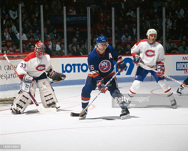 Pat Lafontaine of the New York Islanders skates in front of Patrick Roy of the Montreal Canadiens Circa 1980 at the Montreal Forum in Montreal Quebec...