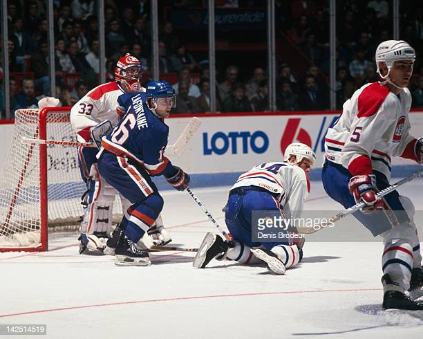 Pat Lafontaine of the New York Islanders stands in front of the net during a game against the Montreal Canadiens Circa 1980 at the Montreal Forum in...