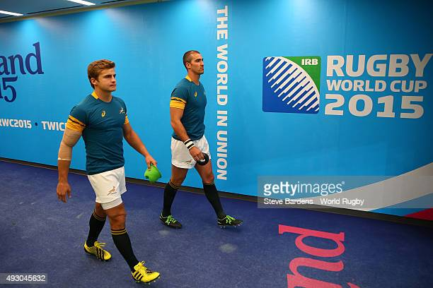 Pat Lambie and Ruan Pienaar of South Africa walk out for the warm up prior to the 2015 Rugby World Cup Quarter Final match between South Africa and...