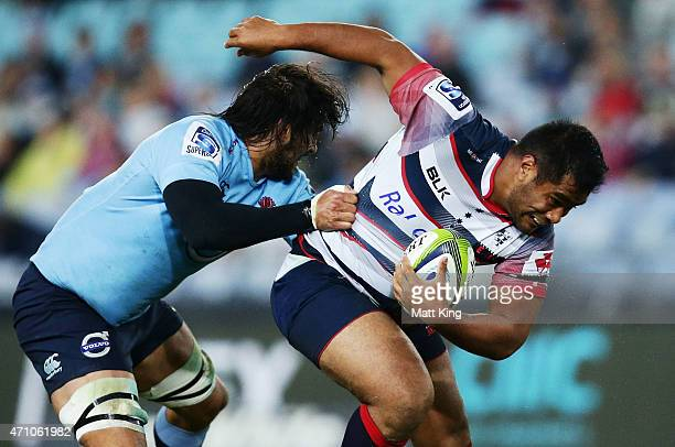 Pat Leafa of the Rebels is tackled by Jacques Potgieter of the Waratahs during the round 11 Super Rugby match between the Waratahs and the Rebels at...