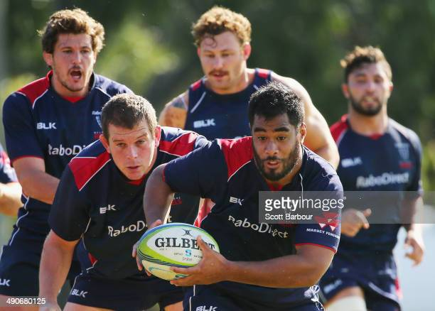 Pat Leafa of the Rebels runs with the ball during a Melbourne Rebels Super Rugby training session at Marcellin College on May 15 2014 in Melbourne...