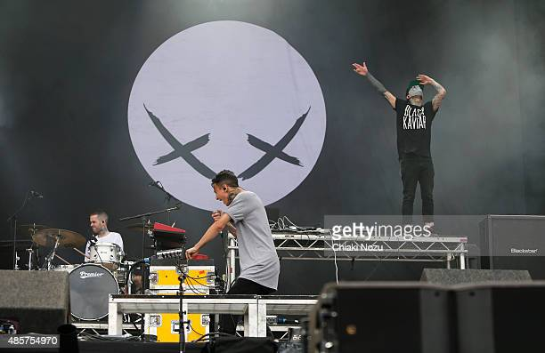 Pat Lundy Josh Friend and Tony Friend of Modestep perform on Day 2 of the Reading Festival at Richfield Avenue on August 29 2015 in Reading England