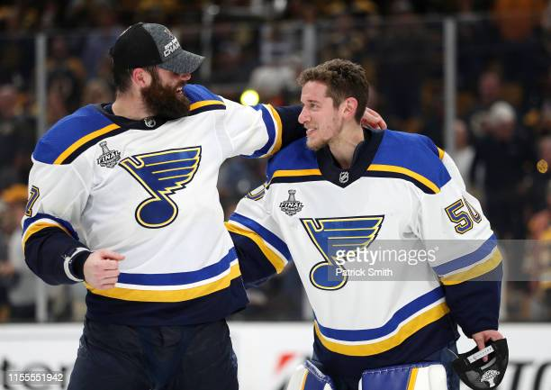Pat Maroon and Jordan Binnington of the St Louis Blues celebrate after defeating the Boston Bruins in Game Seven of the 2019 NHL Stanley Cup Final at...