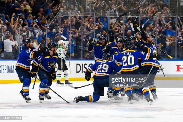 Pat Maroon of the St. Louis Blues is congratulated after scoring the game winning goal against the Dallas Stars in double overtime in Game Seven of...