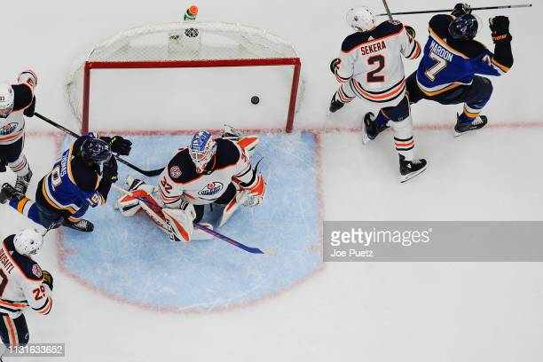 Pat Maroon of the St Louis Blues reacts after scoring a goal past Anthony Stolarz of the Edmonton Oilers at Enterprise Center on March 19 2019 in St...