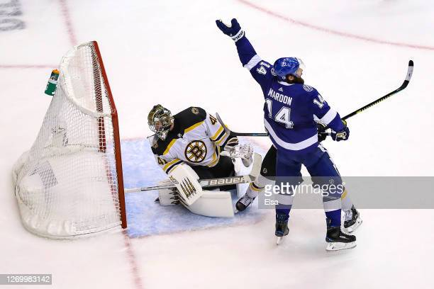 Pat Maroon of the Tampa Bay Lightning celebrates as the gamewinning goal from teammate Victor Hedman goes past Jaroslav Halak of the Boston Bruins...