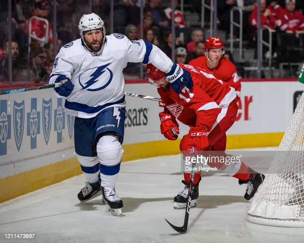 Pat Maroon of the Tampa Bay Lightning follows the play in front of Filip Hronek of the Detroit Red Wings during an NHL game at Little Caesars Arena...