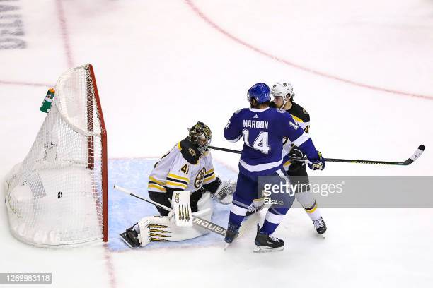 Pat Maroon of the Tampa Bay Lightning watches as the gamewinning goal from teammate Victor Hedman goes past Jaroslav Halak of the Boston Bruins...
