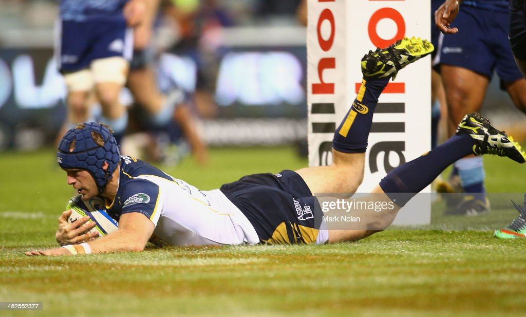 Pat McCabe of the Brumbies scores a try during the round eight Super Rugby match between the Brumbies and the Bulls at Canberra Stadium on April 4, 2014 in Canberra, Australia.