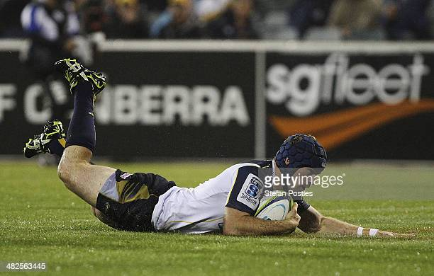 Pat McCabe of the Brumbies scores a try during the round eight Super Rugby match between the Brumbies and the Bulls at Canberra Stadium on April 4,...