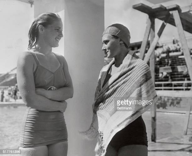 Pat McCormick of Long Beach California a member of the US Women's Olympic Swimming Team meets Soviet Olympic Swimming girl Sjuniezowa at the Olympic...