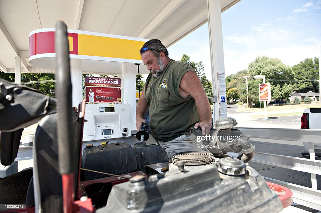 Pat McSherry, owner of Partners With Nature lawn and garden service, fills up a lawn mover at a Royal Dutch Shell Plc gas station in Peoria, Illinois, U.S., on Wednesday, Sept. 11, 2013. Gasoline climbed in New York trading as crude advanced before talks between the U.S. and Russia over disposing of Syrias chemical weapons and as U.S. jobless claims dropped. Photographer: Daniel Acker/Bloomberg via Getty Images