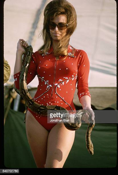 Pat Miller known as 'Serpantina' holds her eight foot boa constrictor after her sideshow appearance in the Hoxie Brothers Circus | Location Eastmen...
