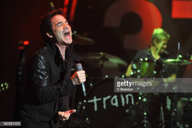 Pat Monahan and Scott Underwood of Train perform on stage at Hammersmith Apollo on February 22 2013 in London England
