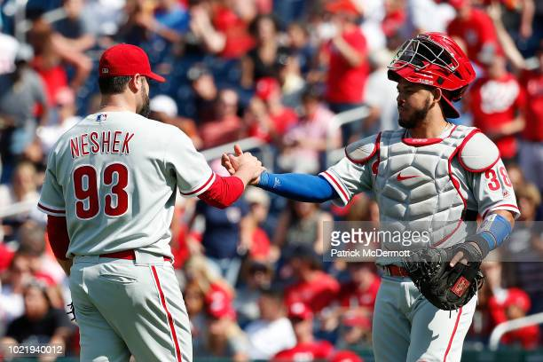 Pat Neshek and Jorge Alfaro of the Philadelphia Phillies celebrate after the Phillies defeated the Washington Nationals 2-0 at Nationals Park on...