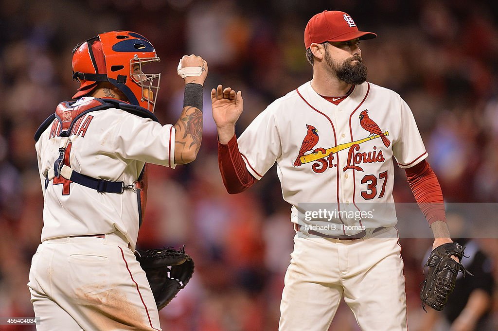 Pat Neshek #37 and Yadier Molina #4 both of the St. Louis Cardinals celebrate after defeating 5-4 at Busch Stadium on September 13, 2014 in St. Louis, Missouri.