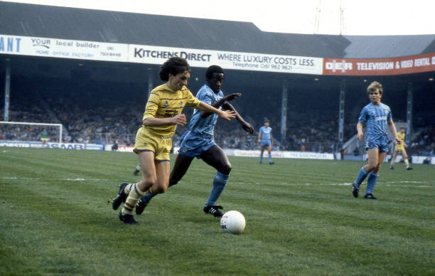 Pat Nevin of Chelsea takes the ball past Clive Wilson of Manchester City during the Canon League Division Two match between Manchester City and...
