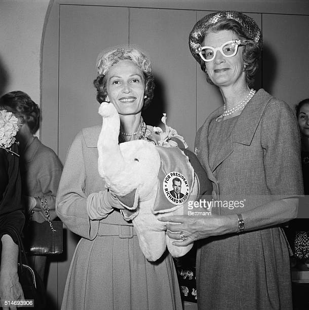 Pat Nixon wife of VicePresident Richard Nixon and Mary Todhunter Clark Rockefeller wife of the New York governor Nelson Rockefeller hold a toy...