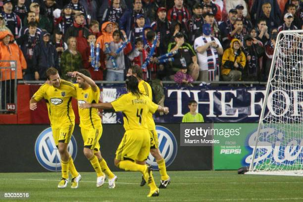Pat Noonan and Gino Padula of the Columbus Crew celebrate with teammate Chad Marshall after Marshall's goal against the New England Revolution at...